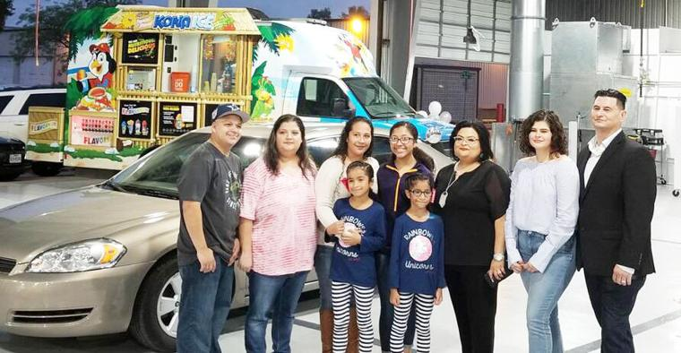 Standing next to their new car are the Gonzalez family of Harlingen. Their eldest daughter Jurrisa standing at the center wrote an essay stating why her family needed a new car. At the left of the family is Christy, Shelby and Aaron Mendez owner of The Collision Stop who helped donate the vehicle to the family.